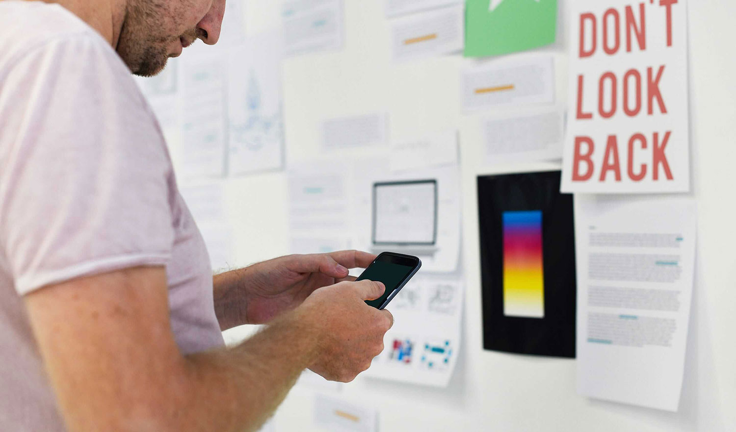 Product Owner standing in front of an inspiration wall for a mobile application