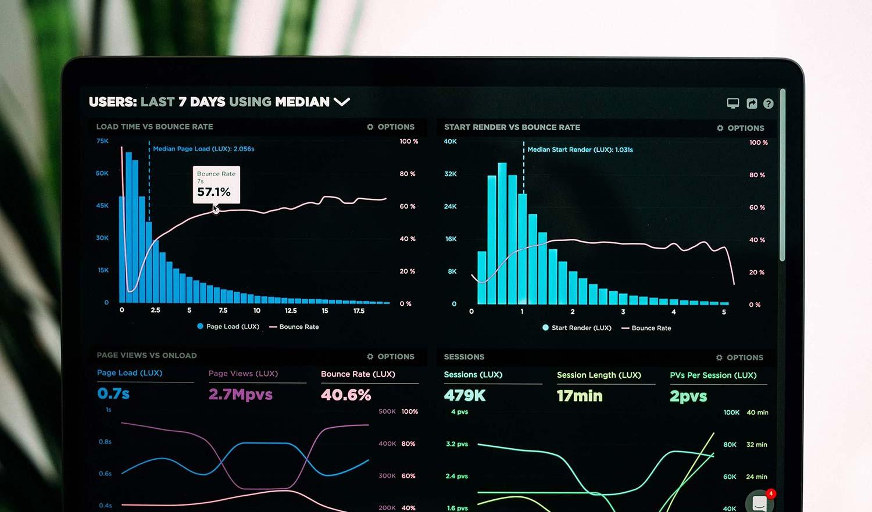 Mobile App Analytics Dashboard on laptop screen
